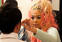 A male customer is transformed with ganguro make-up by Pomitan (24), store manager, at the Ganguro Cafe &amp; Bar in the Shibuya shopping area on September 4, 2015. <br /> <br /> Ganguro is an alternative Japanese fashion trend which started in the mid-1990s where young women, rebelling against the traditional idea of Japanese beauty, wore colorful make-up and clothes and had dark-skin.<br /> <br /> 10 Ganguro fashion girls work in the new bar, which offers original Ganguro Balls (fried takoyaki style sausage balls in black squid ink batter) on its menu. Ganguro Caf&eacute; &amp; Bar also offers special services such as Ganguro make-up and the chance to take purikura (photo booth pictures) with staff and to look like a Ganguro girl walking around the Shibuya streets.<br /> <br /> The bar is popular with both Japanese and foreigners and has menus translated in English. (Photo by Rodrigo Reyes Marin/AFLO)