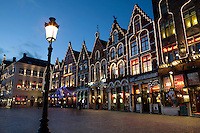 Belgium, West-Flanders, Bruges: Restaurants in the Market Square at dusk