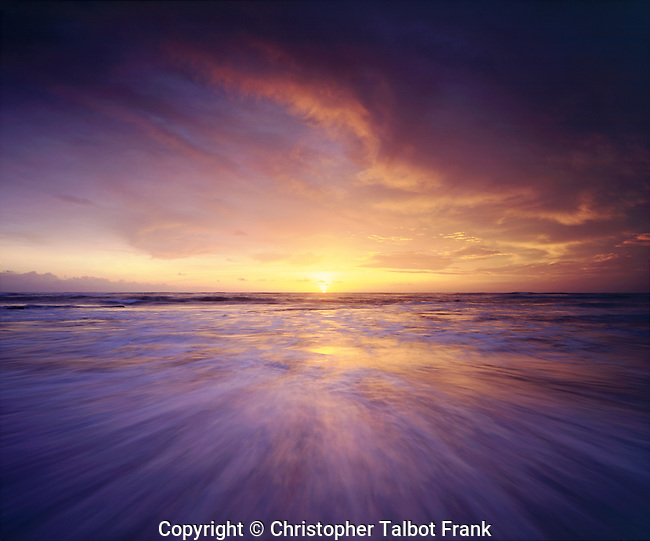 USA, California, San Diego.   Sunset Cliffs Beach on the Pacific Ocean reflecting the Sunset.