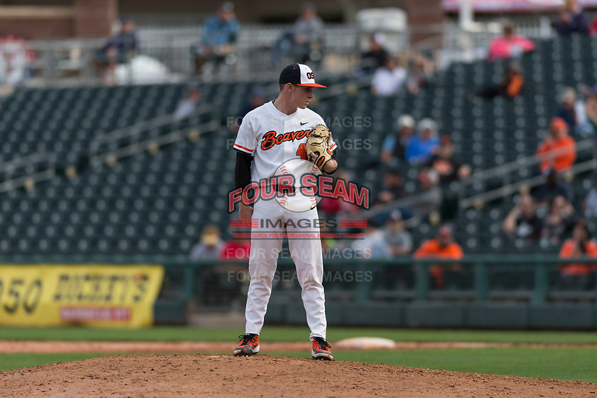 Oregon State Beavers relief pitcher Dylan Pearce (49) looks to his catcher for the sign during a game against the New Mexico Lobos on February 15, 2019 at Surprise Stadium in Surprise, Arizona. Oregon State defeated New Mexico 6-5. (Zachary Lucy/Four Seam Images)