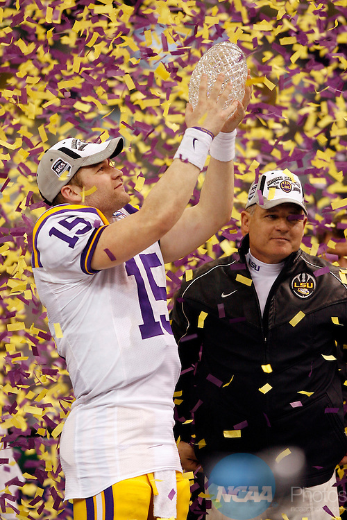 07 JAN 2008:  Offensive MVP Matt Flynn (15) and Head Coach Les Miles of Louisiana State University celebrate the Tigers victory over Ohio State University during the BCS National Championship held at the Superdome in New Orleans, LA.  LSU defeated Ohio State 38-24 for the national title.  Jamie Schwaberow/NCAA Photos