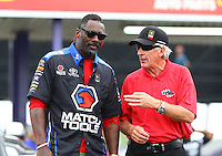 Apr 24, 2015; Baytown, TX, USA; Mike Lewis (right) and movie actor Idris Elba in attendance during NHRA qualifying for the Spring Nationals at Royal Purple Raceway. Mandatory Credit: Mark J. Rebilas-