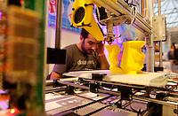 Stampanti 3D per la produzione di oggetti, in azione alla Maker Faire, mostra sull'innovazione tecnologica, a Roma, 4 ottobre 2014.<br /> 3D printers for production of objects, in action at the Maker Faire exhibition on technological innovation in Rome, 4 October 2014.<br /> UPDATE IMAGES PRESS/Riccardo De Luca