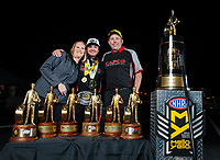 Nov 11, 2018; Pomona, CA, USA; NHRA top fuel driver Steve Torrence poses for a portrait with crew members as he celebrates after winning the Auto Club Finals at Auto Club Raceway. Torrence swept all six of the countdown to the championship races to clinch the world championship. Mandatory Credit: Mark J. Rebilas-USA TODAY Sports