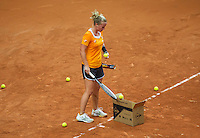 Arena Loire,  Trélazé,  France, 14 April, 2016, Semifinal FedCup, France-Netherlands, Dutch team practise, Richel Hogenkamp collecte balls<br /> Photo: Henk Koster/Tennisimages
