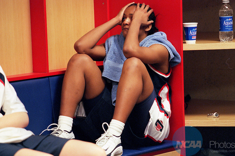 30 MAR 2001:  Forward Tamika Williams (34) of the University of Connecticut sits dejectedly in the locker room after their loss to Notre Dame during the Division 1 Women's Basketball Semifinals held at the Savvis Center in St. Louis, MO.  Notre Dame defeated UCONN 90-75 to advance to the national championship game.  Jamie Schwaberow/NCAA Photos