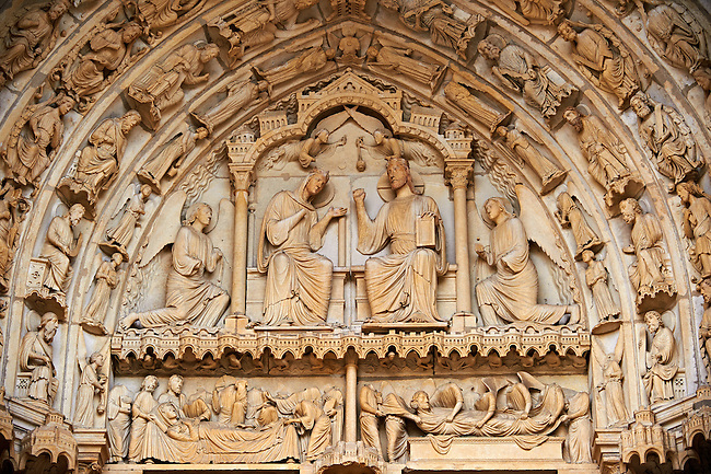West Facade, right Royal Portal - General View of Tympanum c. 1145. Cathedral of Chartres, France . Tympanum - Virgin and Child enthroned, flanked by angels..Upper Lintel - the Presentation at the Temple.Lower Lintel - Nativity Scenes (The Annunciation to the Virgin, the Visitation, the Nativity, Annunciation to the Shepherds).Inner archivolt - angels..Outer archivolts - Liberal Arts and their associated scribes. (See discussion in Katzenellenbogen, pp. 15-21 and in Kidson, pp. 20-1). On the bottom left are the Zodiac signs of Pisces and Gemini . A UNESCO World Heritage Site. .