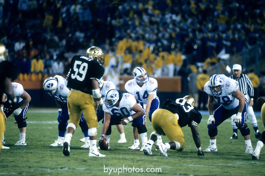 FTB 8812 171 Colorado<br /> <br /> Freedom Bowl- BYU vs Colorado. 14 Ty Detmer Quarterback. Offensive Linemen: 66 Mohammed Elewonibi. 60 Phil Nauahi. 78 Warren Wheat.<br /> <br /> December 29, 1988<br /> <br /> Box Number: 23086<br /> <br /> Photo by: Mark Philbrick/BYU<br /> <br /> Copyright BYU PHOTO 2008<br /> All Rights Reserved<br /> 801-422-7322<br /> photo@byu.edu