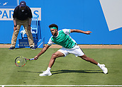 June 19th 2017, Queens Club, West Kensington, London; Aegon Tennis Championships, Day 1; Jo-Wilfried Tsonga of France reaches low to play the shot during his game with Adrian Mannarino