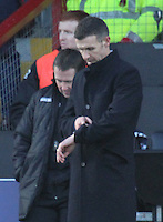Ross County Manager Jim McIntyre checks his watch near half time in the Ross County v St Mirren Scottish Professional Football League match played at the Global Energy Stadium, Dingwall on 17.1.15.