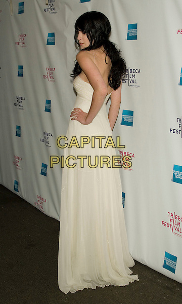 """RUMER WILLIS .2008 Tribeca Film Festival - World Premiere of """"From Within"""".at the AMC 19th Street Theater, .New York, NY, USA, April 25, 2008..full length white ivory straps strapless back over shoulder hand on hip rear .CAP/LNC/TOM.©LNC/Capital Pictures"""