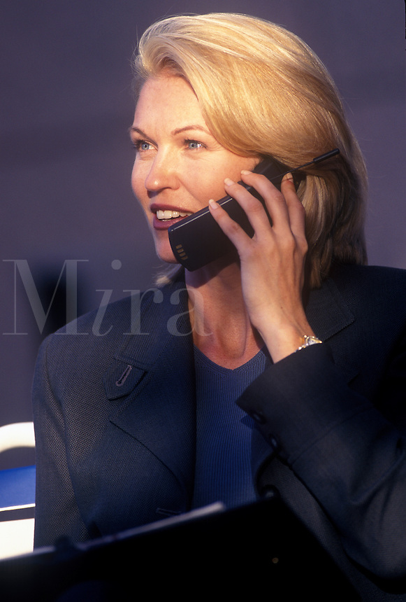 Woman discussing business by cell phone.