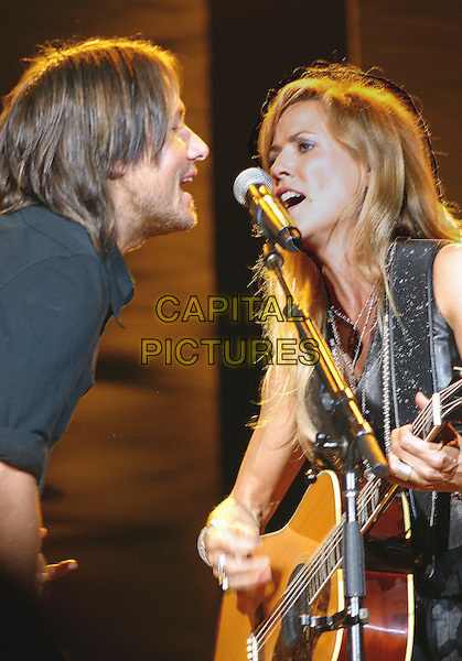 KEITH URBAN & SHERYL CROW.Sheryl Crow makes a tour stop and performs for a soldout crowd at Starwood Amphitheatre, Nashville, Tennessee, USA..October 8th, 2006.Ref: ADM/RR.stage concert live gig performance music guitar half length singing.www.capitalpictures.com.sales@capitalpictures.com.©Randi Radcliff/AdMedia/Capital Pictures