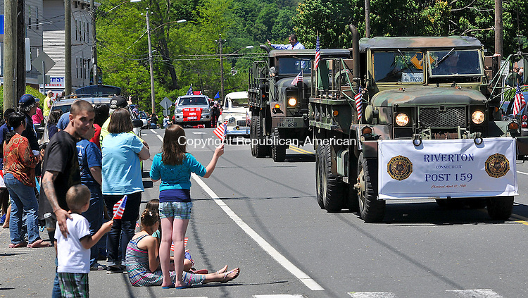 WINSTED, CT 27 MAY 2013--052713JS10- People wave American flags as members of Riverton American Legion Post 159 make their way past during the annual Winsted Memorial Day parade on Monday. .Jim Shannon Republican American
