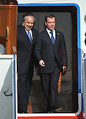Russian President Dmitry Medvedev (R) and Russian Ambassador to the U.S. Sergey Kislyak arrive for the Nuclear Security Summit, at Andrews Air Force Base, Maryland, April 12, 2010.  .Credit: Kevin Dietsch / Pool via CNP