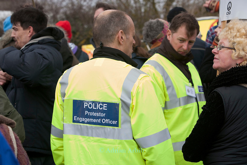 ' Police engagement officers '  try to talk to Protesters at a march against the building of  Hinkley C power station, Somerset  and the UK government's choice of Nuclear power as the mainstay of England's power supply.