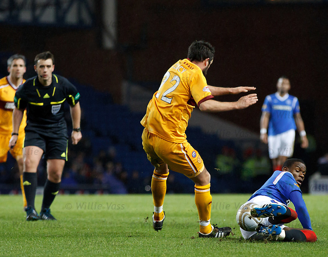 Referee Euan Norris books Maurice Edu for this tackle on Tim Clancy