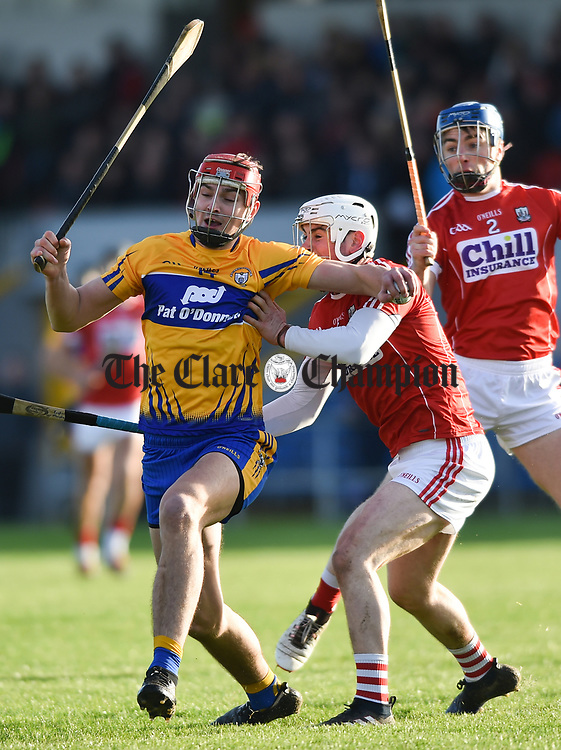 Peter Duggan of Clare in action against Eoin Murphy and Conor O Sullivan of Cork during their Munster Hurling League game at Cusack Park. Photograph by John Kelly.