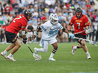 Baltimore, MD - April 28, 2018: Johns Hopkins Blue Jays Daniel Jones (23) gets the ground ball during game between John Hopkins and Maryland at  Homewood Field in Baltimore, MD.  (Photo by Elliott Brown/Media Images International)