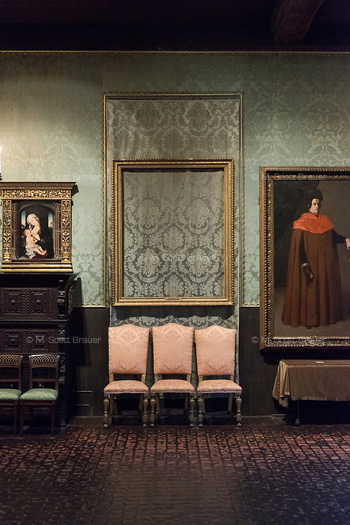 "An empty frame hangs on the wall where Rembrandt's ""The Storm on the Sea of Galilee"" once hung in the Isabella Stewart Gardner Museum's ""Dutch Room,"" in Boston, Mass., USA, seen here on Tues., Dec. 5, 2017. The painting was stolen during a 1990 theft of 13 objects from the museum: 10 paintings, 2 objects, and 1 etching. One of the objects stolen was a Shang Dynasty ku (or gu), a bronze beaker, which stood on the table at right under the painting of the man in red, Zurburan's painting ""A Doctor of Law,"" at right."