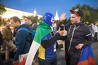 MOSCOW, RUSSIA - June 14, 2018: A Mexico and Russia fan shake hands at Alexander Garden just outside Red Square after the opening match of the 2018 FIFA World Cup between Russia and Saudi Arabia. Russia defeated Saudi Arabia 5-0.