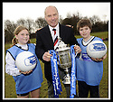 24/02/2009  Copyright Pic: James Stewart.File Name : sct_jspa03_scottis_cup.FORMER FALKIRK LEGEND ALEX TOTTEN SHOWS OFF THE HOMECOMING SCOTLAND SCOTTISH CUP TO SARAH JOHNSTON AND IAN MCARTHUR, PRIMARY SEVEN PUPILS AT ST MARGARET'S PRIMARY SCHOOL, POLMONT......Press Release..... A unique interactive tour to engage primary school children with football and the Homecoming Scottish Cup rolls into town today, Tuesday 24 February 2009 at St Margaret's Primary School in Falkirk.  . .Up to 100 pupils in primaries 5 to 7 at each local school will receive specialist skills and drill training from Scottish Football Association coaches as well as getting the chance to view the Homecoming Scottish Cup trophy itself.. .The school tour takes the form of a giant 'football-shaped' tent, which houses the world's oldest footballing trophy and information about Homecoming Scotland and the Scottish Cup tournament.. .Future football stars will be given soccer skills training ahead of watching their home team, Falkirk, take on Inverness Caledonian Thistle in the quarter finals of the Homecoming Scottish Cup on the weekend of 7 March.. .Falkirk legend Alex Totten, who used to manage the side, will be on hand at St Margaret's Primary School to share his knowledge and experience with the kids and to see the trophy himself.. .All primary schools in Scotland will also be sent education packs to encourage pupils to know more about Homecoming Scotland and to learn more about healthy eating, fitness and playing football as a way to keep fit and have fun.  . .As part of the football celebrations, the tour will then encourage locals in the town centre to get behind their local team, when the cup visits The Mall in Falkirk later in the afternoon.. .The Homecoming Scottish Cup Tour has been designed to engage with Scotland's local communities and spread the message about joining in the celebrations for Homecoming Scotland 2009, a programme comprising over 300 events to celebrate Scotland's culture, h