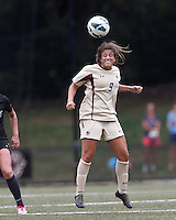 Boston College forward Stephanie McCaffrey (9) heads the ball. After two overtime periods, Boston College tied University of Central Florida, 2-2, at Newton Campus Field, September 9, 2012.