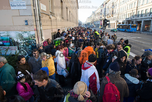 People in need queue for free food distributed by Krishna charity activists during Christmas holiday in central Budapest, Hungary on December 24, 2014. ATTILA VOLGYI