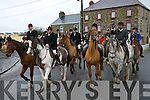 HUNT: Members of Kerry Harriers Pony Club on the move in Ballyheigue with their hounds at the Kerry Harriers Pony Club Hunt on Sunday.