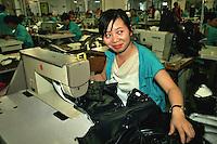 Bacau / Romania<br /> La Sonoma, industria tessile dove vengono prodotti capi di lusso per vari marchi importanti del 'Made in Italy', è un vero esempio di globalizzazione nel mondo del lavoro: fabbrica rumena, AD italiano, operai provenienti da Cina e Bangladesh. Nella foto un reparto di operaie cinesi, Vivono nella fabbrica, lavorano il doppio di un operaio rumeno e costano la metà.<br /> Sonoma textil factory in Bacau is an example of globalization: italian AD, romanian factory, workers from Chine and Bangladesh. In the picture some rumanian workers become the minority becouse of the salary. The cost of workers coming from Asia is half and they can work more hours and seved days a week. Photo Livio Senigalliesi