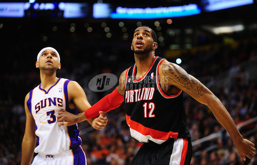 Jan. 14, 2011; Phoenix, AZ, USA; Portland Trailblazers forward (12) LaMarcus Aldridge and Phoenix Suns forward (3) Jared Dudley at the US Airways Center. The Suns defeated the Trailblazers 115-111. Mandatory Credit: Mark J. Rebilas-