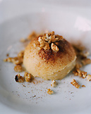 TURKEY, Istanbul, close-up of Semolina Halva dessert at Tugra Restaurant.