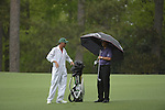 AUGUSTA, GA - APRIL 12: Phil Mickelson looks onto the fairway with his caddie during the Second Round of the 2013 Masters Golf Tournament at Augusta National Golf Club on April 10in Augusta, Georgia. (Photo by Donald Miralle) *** Local Caption ***
