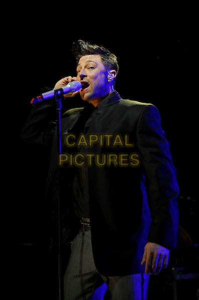 Duncan James of Blue.Blue performing in concert, Shepherd's Bush Empire, London, England, UK, 3rd May 2013.music concert gig live on stage audience half length black microphone jacket .CAP/MAR.© Martin Harris/Capital Pictures.