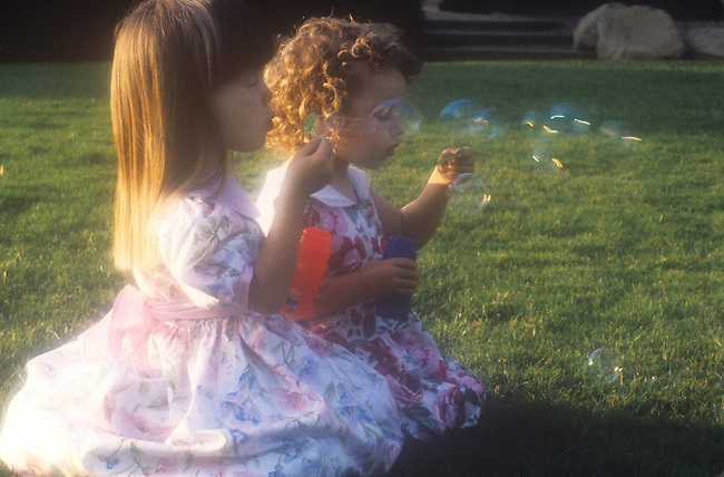 Young Girls Playing Together, Blowing Soap Bubbles<br /> MODEL RELEASED