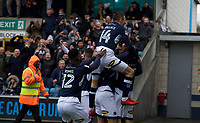 Millwall players celebrate after Shaun Williams scores the opening goal during the Sky Bet Championship match between Millwall and Nottingham Forest at The Den, London, England on 30 March 2018. Photo by Alan  Stanford / PRiME Media Images.