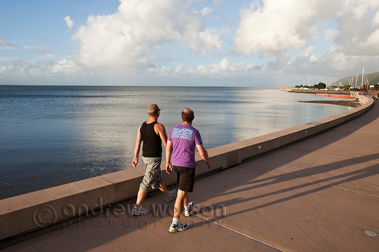 Men walking along the Esplanade.  Cairns, Queensland, Australia