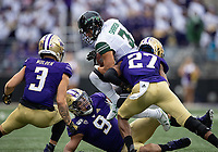 The Husky defense swarms Jason-Matthew Sharsh after Sharsh made a tough catch in traffic.
