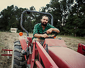 George O'Neal, of Lil' Farm, established The Sustainable Agriculture Tool Lending Library to share essential tools, like an array of implements used for this tractor, among 10 local farms with the support of a $30,000 grant The Tobacco Communities Reinvestment Fund.