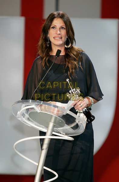 "JULIA ROBERTS.""Eat Pray Love"" premiere and Donostia Award during the 58th International Film Festival San Sebastian, San Sebastian, Spain, September 20th, 2010.half length black sheer dress award trophy holding  gold bracelets see thru through speaking podium microphone .CAP/PE.©Peter Eden/Capital Pictures."