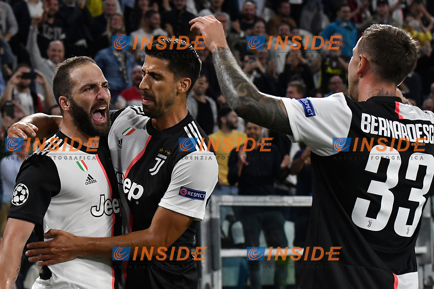 Gonzalo Higuain of Juventus celebrates with Sami Khedira and Federico Bernardeschi after scoring the goal of 1-0 for his side <br /> Torino 01/10/2019 Juventus Stadium <br /> Football Champions League 2019//2020 <br /> Group Stage Group D <br /> Juventus - Leverkusen <br /> Photo Andrea Staccioli / Insidefoto