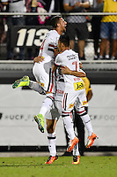 Orlando, FL - Saturday Jan. 21, 2017: São Paulo defender Lucão (4) and São Paulo forward Neilton (7) jump into the open arms of São Paulo forward Gilberto (17) after his successful game deciding penalty shot during the penalty kick shootout of the Florida Cup Championship match between São Paulo and Corinthians at Bright House Networks Stadium. The game ended 0-0 in regulation with São Paulo defeating Corinthians 4-3 on penalty kicks.