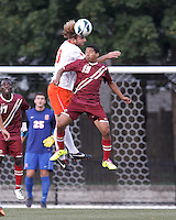 Syracuse University defender Chris Makowski (20) and Boston College forward/midfielder Zeiko Lewis (19) battle for head ball. Boston College (maroon) defeated Syracuse University (white/orange), 3-2, at Newton Campus Field, on October 8, 2013.