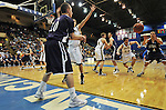 19 MAR 2011:  Guard Peter Leslie (44) of St. Thomas passes the ball in to teamate Tyler Nicolai (4) during the Division III Men's Basketball Championship held at the Salem Civic Center in Salem, VA. The University of St. Thomas (Minnesota) defeated College of Wooster 78-54 to win the national title.  Andres Alonso/NCAA Photos