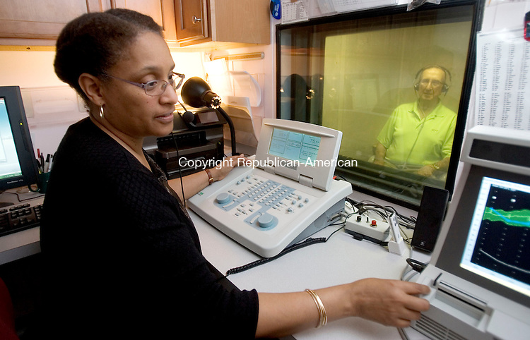 WATERBURY CT. 19 May 2014-051914SV02-Dr. Annette Burton, AUD, gives a hearing test to Ronald Kenausis of Watertown at Easter Seals in Waterbury Monday. More than 10 percent fo the U.S. population, or 31 million people, has difficulty hearing. The No. 1 culprit is too much noise exposure and there are ways to remedy that, help the already damaged ears. <br /> Steven Valenti Republican-American