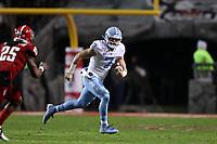 RALEIGH, NC - NOVEMBER 30: Sam Howell #7 of the University of North Carolina runs the ball during a game between North Carolina and North Carolina State at Carter-Finley Stadium on November 30, 2019 in Raleigh, North Carolina.