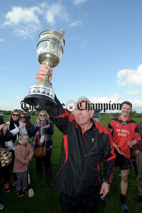 Meelick  manager Pat O Rourke celebrates with the cup following the win over Kilmurry Ibrickane in their Junior A  county final at Gurteen. Photograph by John Kelly.