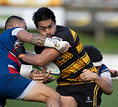 Whaiora Rangiwai and Bryan Mulitalo look to stop Pat Masoe's run. Counties Manukau Premier 1 McNamara Cup Final between Ardmore Marist and Bombay, played at Navigation Homes Stadium on Saturday July 20th 2019.<br />  Bombay won the McNamara Cup for the 5th time in 6 years, 33 - 18 after leading 14 - 10 at halftime.<br /> Photo by Richard Spranger.