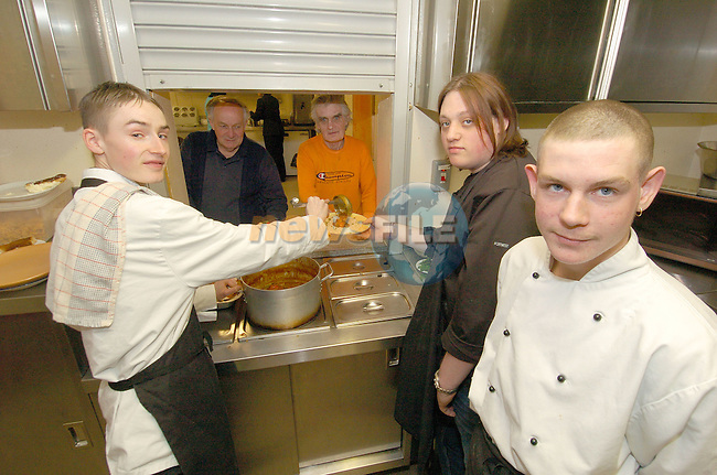 Gary Toner, Sean Gingamellsand Thomas Wilton helping out with St Josephs Residents, Paddy Byrne and Seamus Smith..Photo Fran Caffrey Newsfile.ie..This Picture has been sent to you by Newsfile Ltd..The Studio,.Millmount Abbey,.Drogheda,.Co. Meath,.Ireland..Tel: +353(0)41-9871240.Fax: +353(0)41-9871260.ISDN: +353(0)41-9871010.www.newsfile.ie..general email: pictures@newsfile.ie