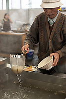 At self-serve (serufu) noodle joints like Kirin and many others in the Sanuki region, customers heat the udon for any hot noodle dishes in simmering tubs provided. This gentleman did so with a practiced grace that suggested years of udon consumption.